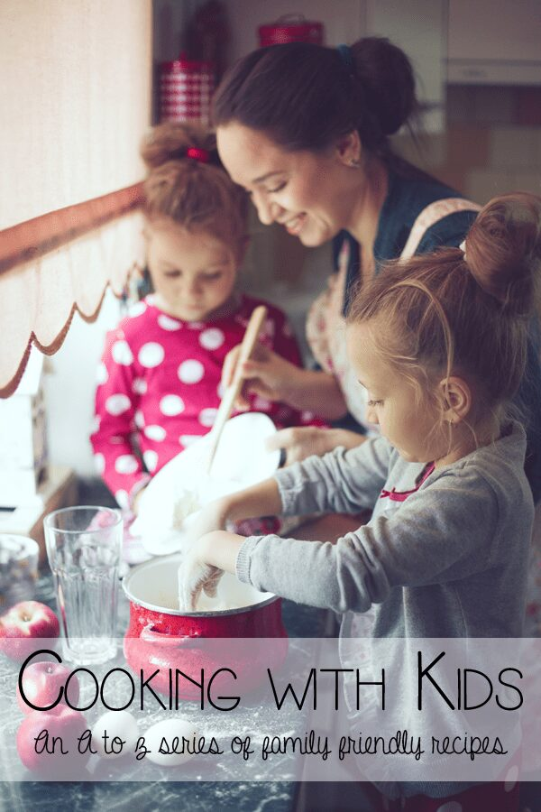 mother and kids cooking in the kitchen with text that says cooking with kids an a to z series of family friendly recipes