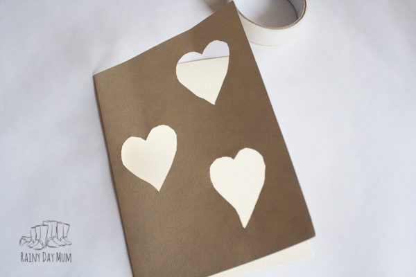 step 3 of how to make a simple valentines card with cut out hearts