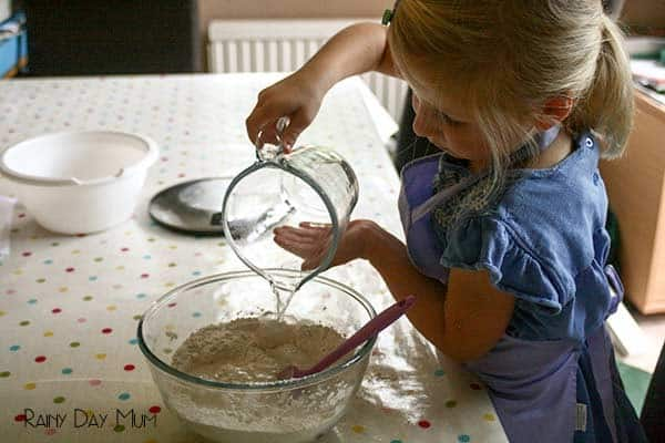 preschooler making bread at home