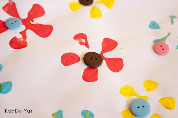 buttons added to stamped flowers for a simple mothers day card