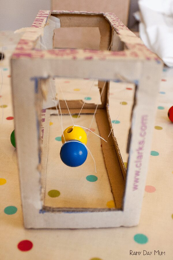 DIY Newton's Cradle from a shoe box