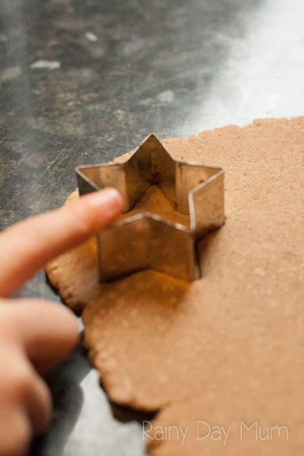 cutting salt dough out with cookie cutters to create salt dough ornaments and decorations