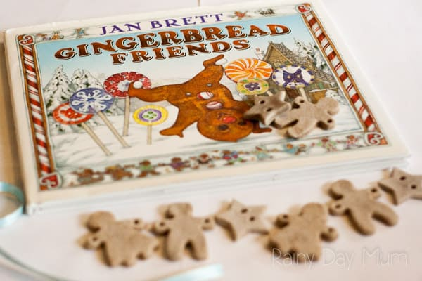gingerbread friends book on a white surface with little gingerbread men and women salt dough decorations below