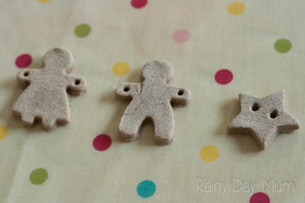 air dried gingerbread salt dough girl, boy and star with holes in to create mini buttons or garlands for Christmas