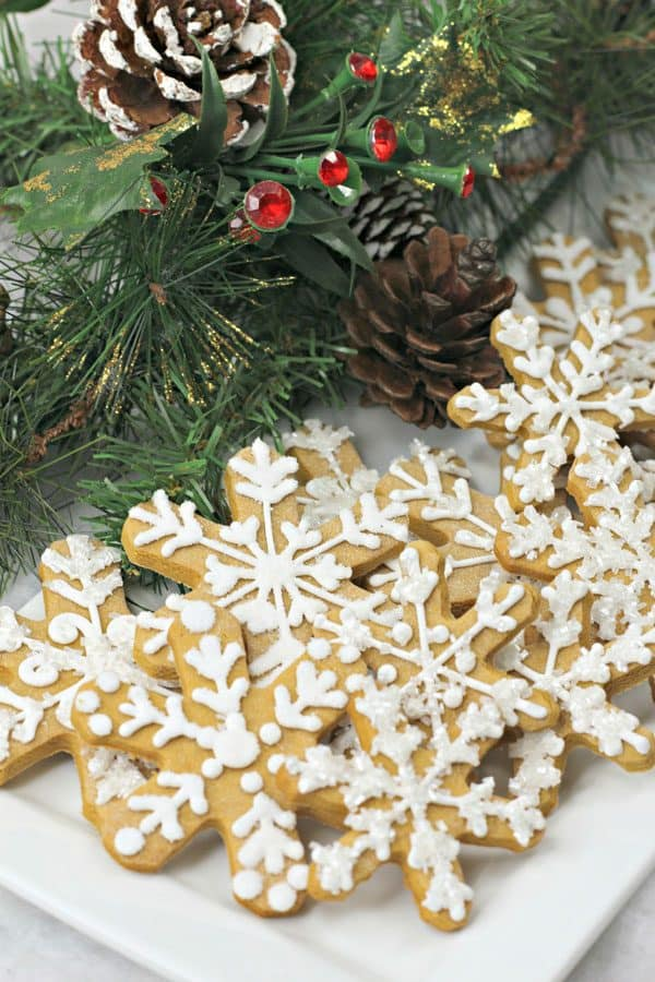 Christmas Gingerbread Snowflake Cookies on a white plate
