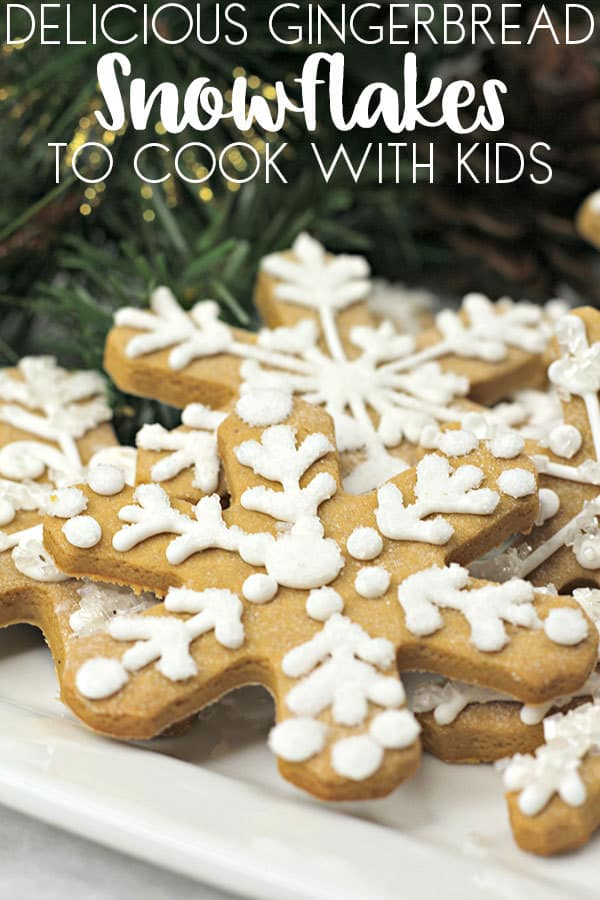 Plate of Gingerbread Snowflakes made with this easy Christmas Cookie Recipe perfect to cook with kids