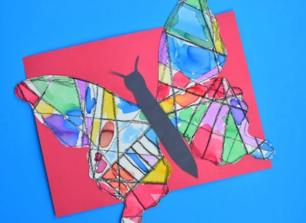 Beautiful stained glass effect butterfly art for kids to create. Ideal for linking learning with The Very Hungry Caterpillar by Eric Carle.
