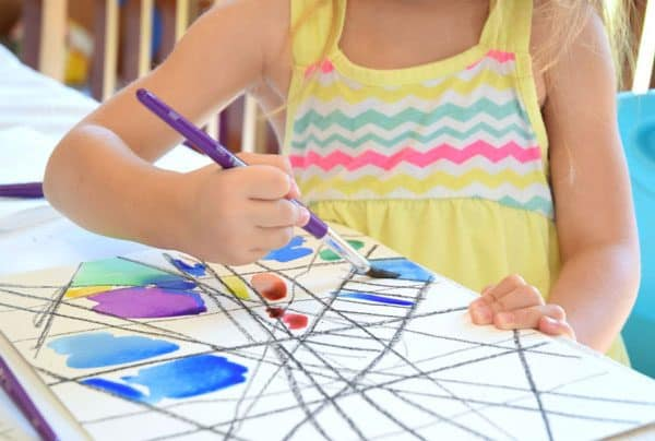 preschooler using watercolor paints