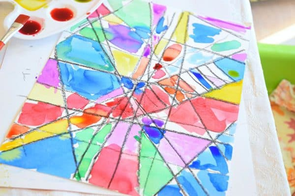 watercolour artwork by preschooler using a wax resist method to create stained glass effect