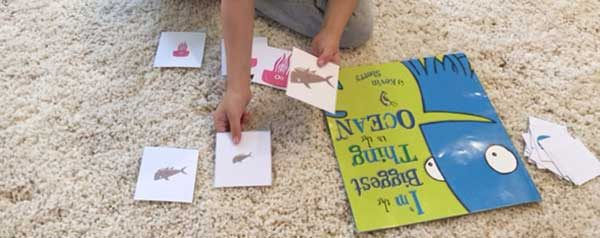 child playing with free printable ocean animal sorting cards