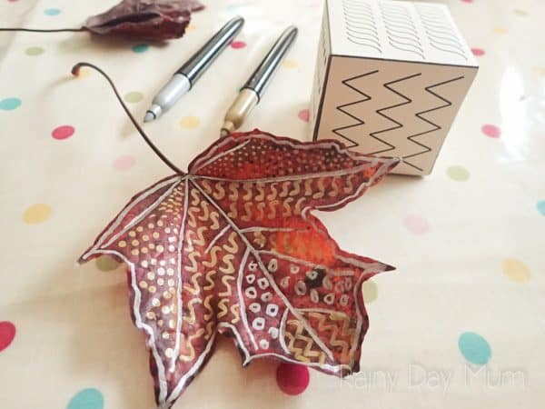 decorated leaf with metalic markers a simple art activity for fall for preschoolers