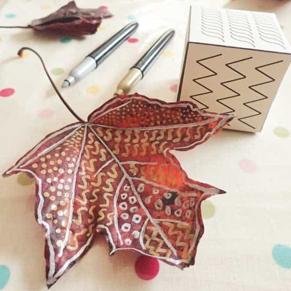 square image of decorated leaf art