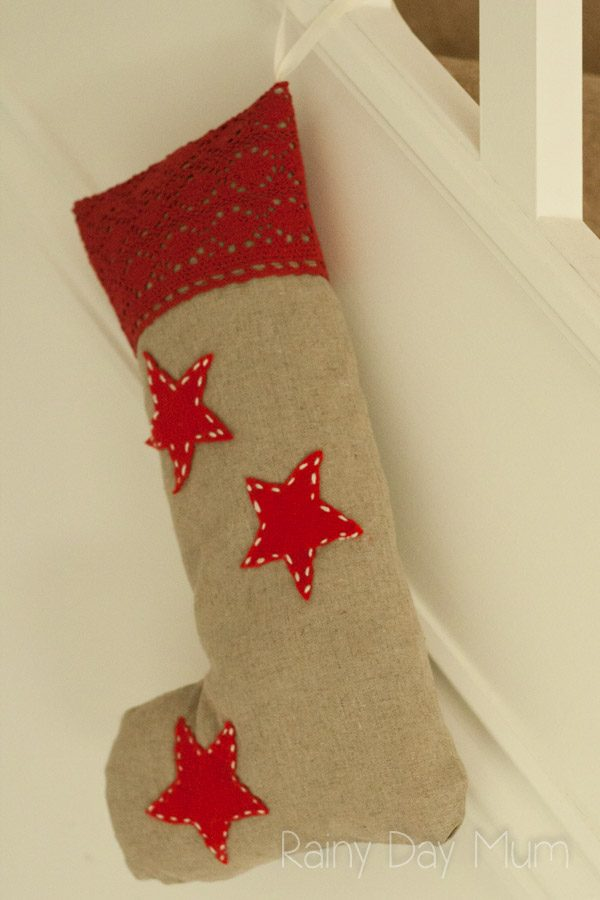 Easy sewing project for beginners using a machine to create a Rustic Stocking that can be hung to decorate the home at Christmas. Full tutorial!