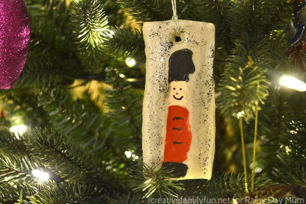 red nutcracker simple saltdough decoration hanging on the Christmas Tree that kids can make