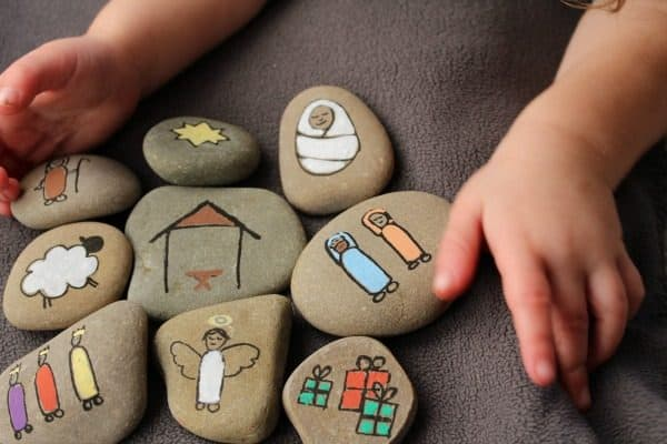 child playing with nativity story stones.