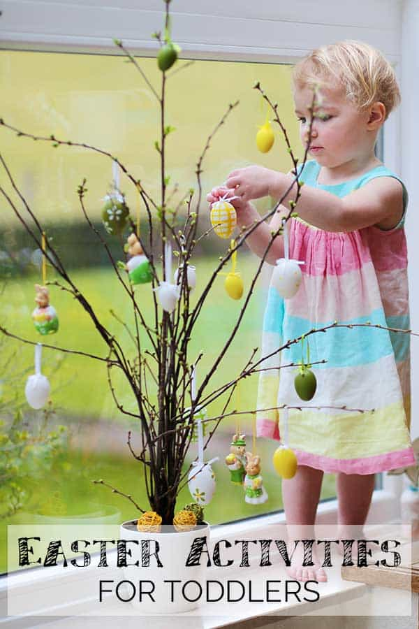 toddler hanging easter eggs on a tree text reads easter activities for toddlers