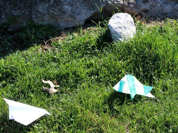 paper airplanes on the ground after a family competition to see who can get them further