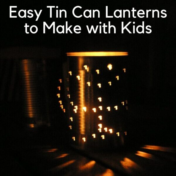 Easy Tin Can Lanterns to Make with Kids, a picture of a tin can which has been punched with holes in the shape of a butterfly, you can see this because of the candle inside which is alight and showing the light through