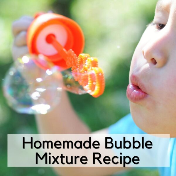 child blowing bubbles with a homemade bubble mix recipe text overlay reads Homemade Bubble Mixture Recipe