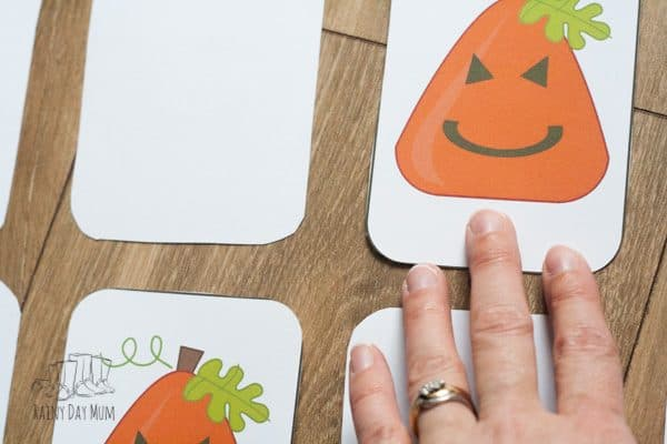 playing games for some halloween maths. printable pumpkin shape card game to learn shapes and practice taking turns as well as work on cognitive skills.