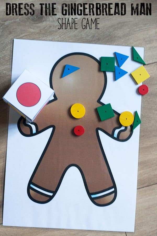 Multiple player DIY math game inspired by The Gingerbread Baby by Jan Bret focusing on learning basic shapes ideal for toddlers and preschoolers to play.
