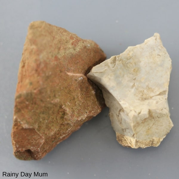 examples of different rocks for testing with kids on a grey surface