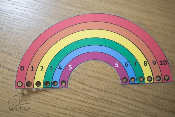 Work on reinforcing number bonds to 10 with this rainbow lacing activity including free printable lacing rainbow. Perfect for helping with number sense and mental arithmetic by getting hands-on learning of the basic number facts.