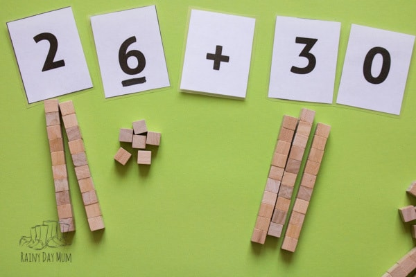 wooden base 10 counters used for addition problems in ks1 and ks2 maths for a home educated child