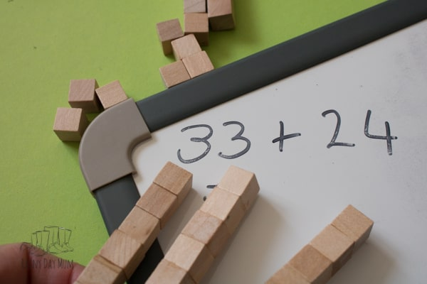 combining base 10 with a white board for hands-on math for homeschooling and homework