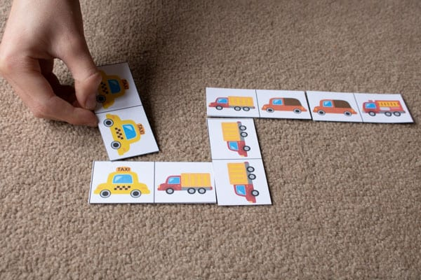 child playing key worker domino game