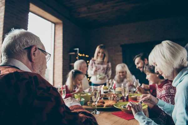 family enjoy a meal together on New Year's Day