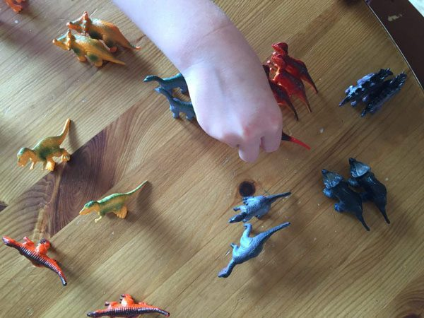 toy dinosaur sorting activity for toddlers