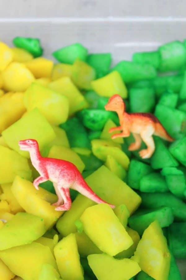 sensory bin on the dinosaur theme