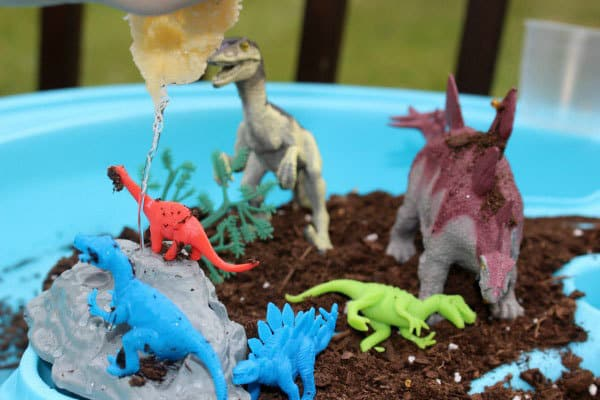Sensory play in the water table with dinosaurs