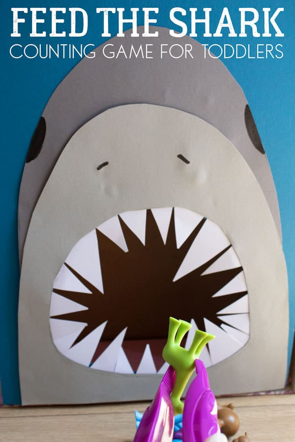 DIY Math Game for toddler sand preschoolers to feed the hungry shark. Count, sort and feed the shark in this fun Shark Week learning activity for young children.