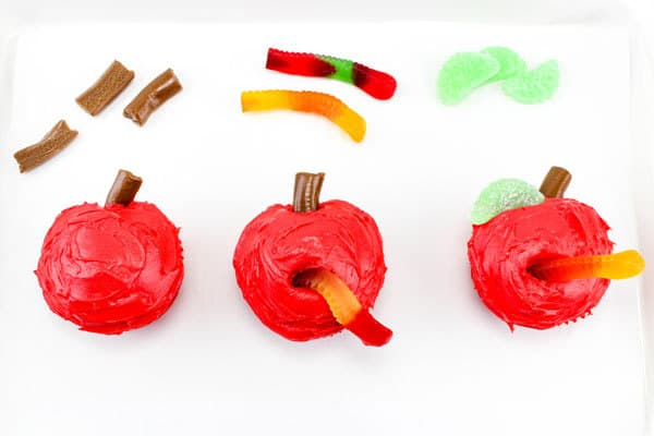 Step by Step guide to creating apple with caterpillar or worm cupcakes
