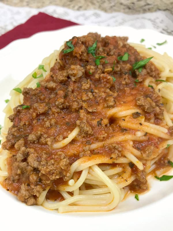Delicious meat sauce for pasta prepared and ready in just 30 minutes or make ahead and freeze for quick meals in the middle of the week. Perfect for family dinning.