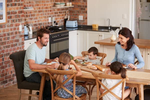 whole family sitting down and eating together. These easy family meal ideas are perfect for even beginner family cooks.