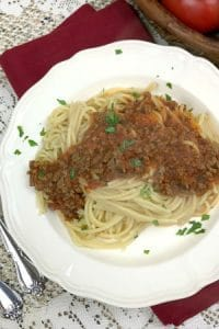 Quick and easy meat sauce for pasta with tomatoes prepared and cooked in 30 minutes. Make up batches and freeze for even easier mid week family meals