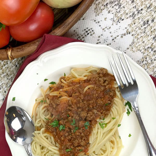 Quick and easy meat sauce for pasta. Rich in tomatoes and perfect for family meals. Make at the weekend, freeze this bolognese sauce and defrost as needed.