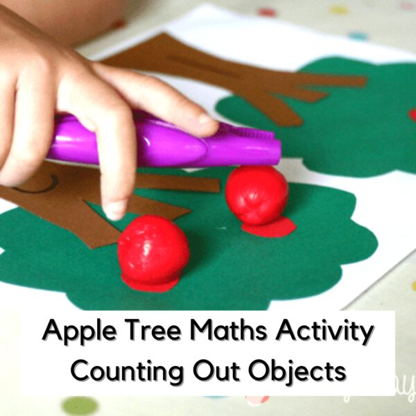 preschooler placing apples with tongs on a paper apple tree for a fall math activity to count objects and work on 1 to 1 correspondance