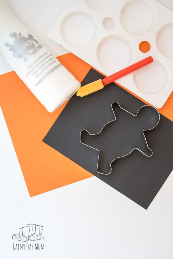 Materials needed to create simple skeletons for toddlers to decorate for Halloween