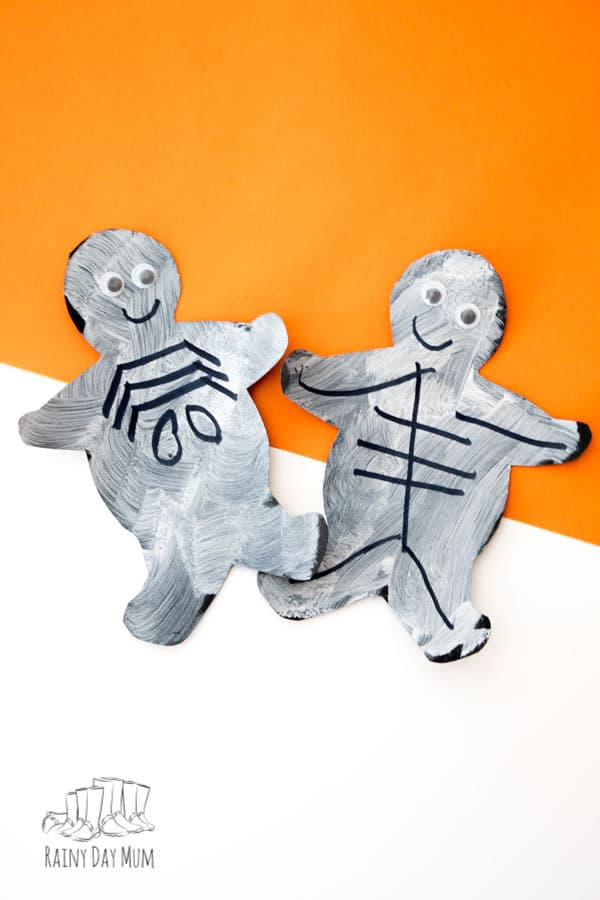 Easy toddler craft for Halloween to make cookie cutter skeletons to decorate