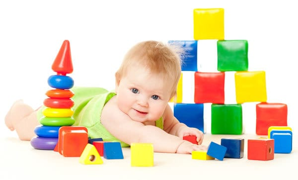 5 month old surrounded by blocks