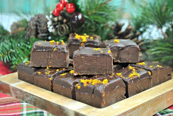 Best ever chocolate orange fudge stacked in front of a Christmas Tree