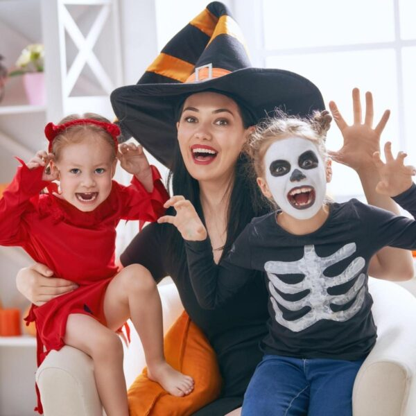 mum and kids having fun at home for Halloween
