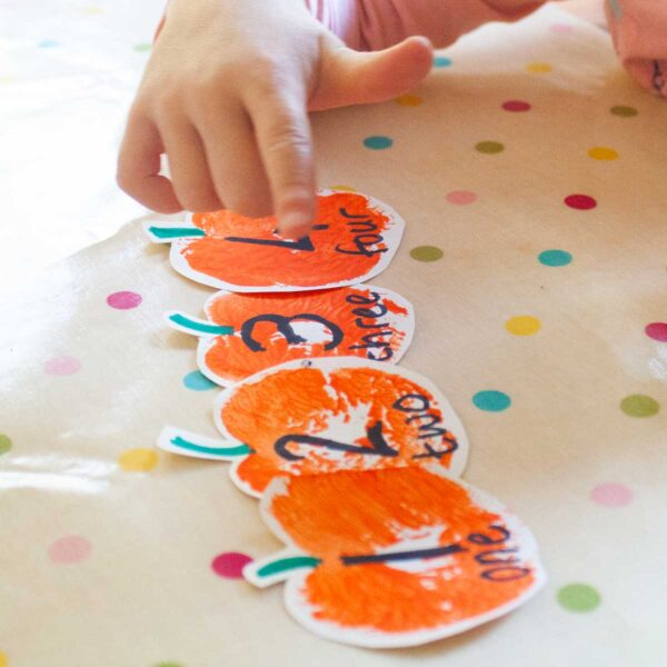 stamped pumpkin diy number line to make with preschoolers at home to support learning to count