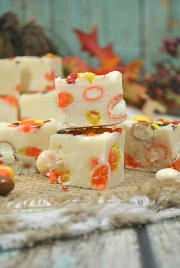 Delicious and easy white chocolate fudge with added candy corns and pumpkin pie M&Ms perfect for fall baking