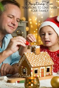 Father and daughter decorating a Gingerbread House on Christmas Eve - a fantastic family tradition to start to create meaningful connections
