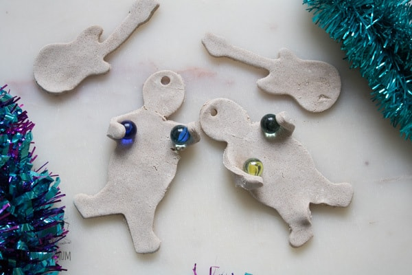 Using a marble to help form salt dough decorations into 3D shapes ideal for creating these Rockin' Gingerbread Ornaments for the Christmas Tree